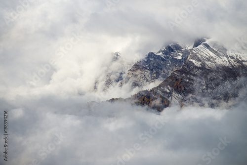Foto op Canvas Bleke violet Aerial image of beautiful mountain landscape with clouds in the Valais Kanton