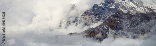 Spoed Foto op Canvas Wit Aerial image of beautiful mountain landscape with clouds in the Valais Kanton