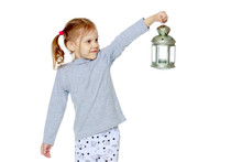 A Little Girl Is Holding A Lamp.