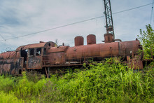 Abandoned Train. Abandoned Railway. Old Rusty Steam Locomotive Overgrown By Plants