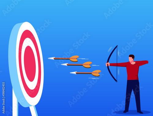 Fotografía  Businessman shoots three arrows at once