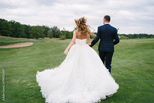 Incredible Full Length Body Portrait Of Young Bride And Groom Running Download Free Architecture Designs Scobabritishbridgeorg