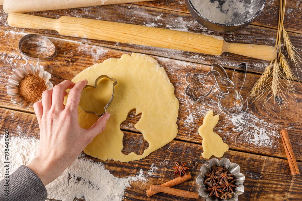 The process of cooking figured cookies. Hand with dough for dough.