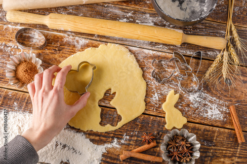 Fototapety, obrazy: The process of cooking figured cookies. Hand with dough for dough.