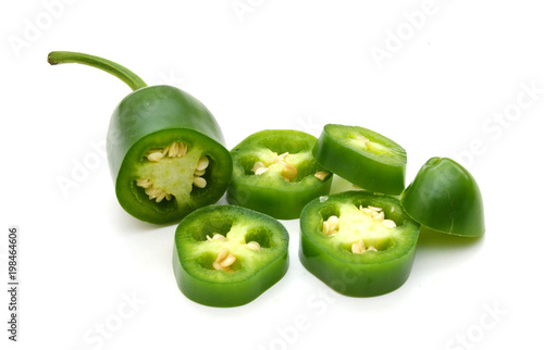 фотография sliced green chilies on white background