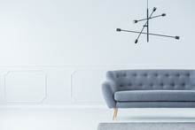 Rods Chandelier Above Gray Sofa