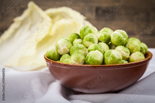 Poster  Bowl of brussel sprouts on a white