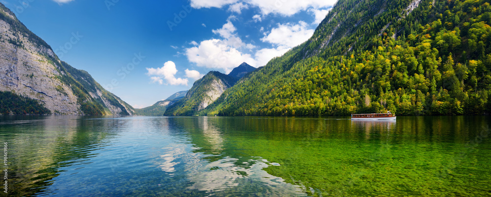 Fototapety, obrazy: Stunning deep green waters of Konigssee, known as Germany's deepest and cleanest lake, located in the extreme southeast Berchtesgadener Land district of Bavaria.