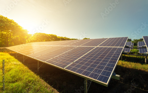 Fotografia  solar panel on sky sunset background.