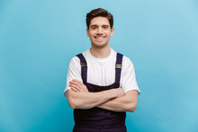 Smiling Male Builder Posing With Cossed Arms