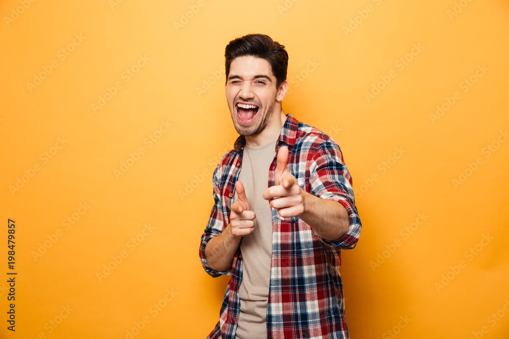 Fototapety, obrazy: Portrait of an excited young man pointing