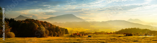 Fototapeten Alpen Breathtaking lansdcape of Austrian countryside on sunset. Dramatic sky over idyllic green fields of Anstrian Central Alps on autumn evening.