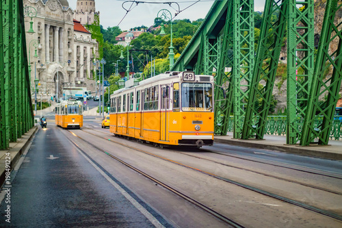 Keuken foto achterwand Oost Europa Freedom Bridge and yellow train in Budapest.