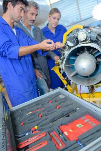 apprentices aeronautical engineers learning with their professor