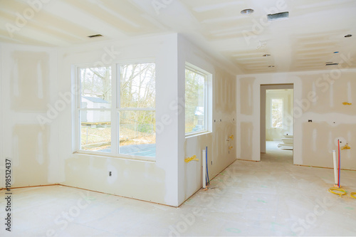 Interior construction of housing project with drywall installed and ...