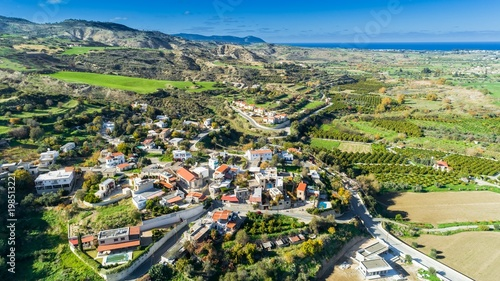 Staande foto Cyprus Aerial bird eye view of Goudi village in Polis Chrysochous valley, Paphos, Cyprus. View of traditional ceramic tile roof houses, church, trees, hills and Akamas - Latchi beach bay from above.
