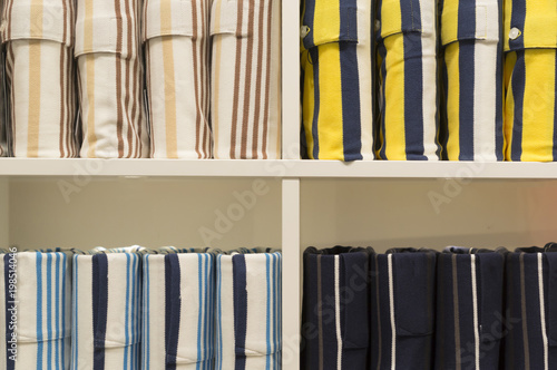 Photo  Elegant colorful polo shirts in strange pile on sale