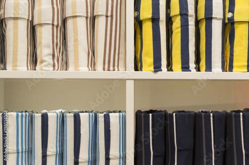 Obraz na plátně Elegant colorful polo shirts in strange pile on sale