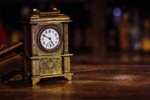 Antique Clock Stand On A Woode...