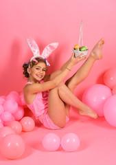 Obraz na płótnie Canvas Cute little girl wearing bunny ears Easter rabbit