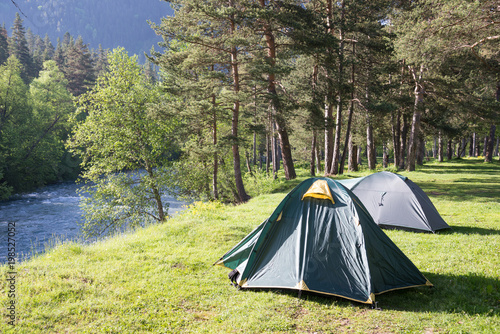 tourist tent camping in mountains adobe stock でこのストック画像を