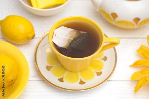 Tea Bright Yellow Tea Set on a White Wood Table