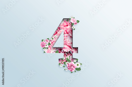 Cuadros en Lienzo A figure of four consisting of pink flowers and green leaves on a light background