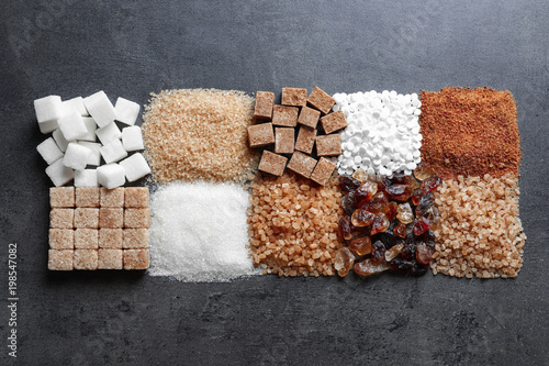 Fotografía  Flat lay composition with different types of sugar on gray background