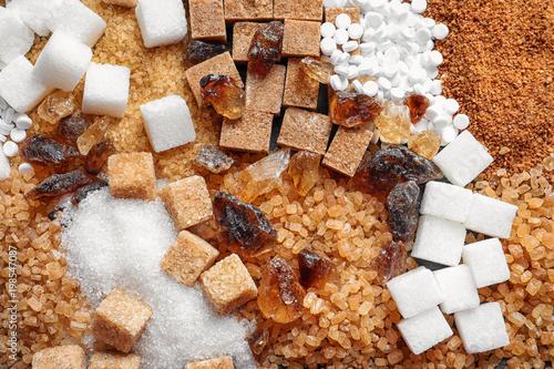 Fototapeta Different types of sugar as background obraz