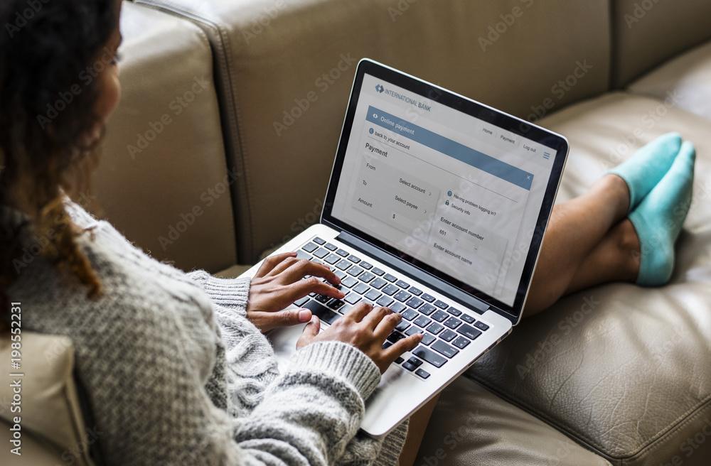 Fototapeta Woman working on a laptop