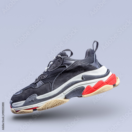 Fotografia  sneaker on a gray background