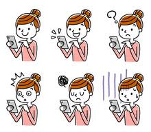 女性:スマートフォン...