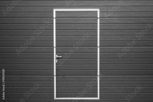 Fotografie, Obraz  Doors made of gray plastic are in the center of the photo