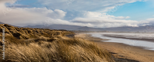 Scenic panorama view of grass covered sand dunes on Banna beach in county Kerry, Fototapeta