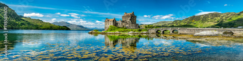 Spoed Fotobehang Landschap Eilean Donan Castle during a warm summer day - Dornie, Scotland