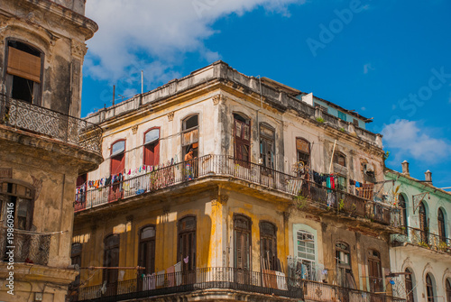 Recess Fitting Havana The view from the bottom up: a classic of the house and blue sky with clouds. Havana. Cuba