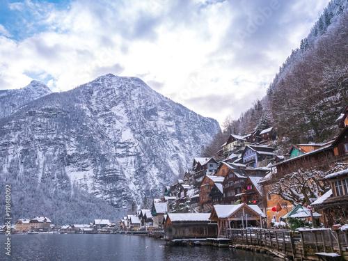 Fototapeta Alpine villages Hallstat in Austria One of the most beautiful winter season snow moutain colorful house obraz na płótnie