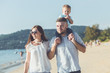 Father, Mother and Kid with relax activity, walking and playing on the tropical beach