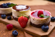 Three Mini Cheesecakes, One Wi...