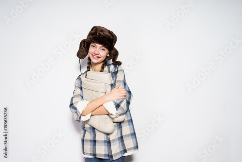 fe360828cfb beautiful young russian girl in warm fur hat holds warm winter felt boots  and smiles