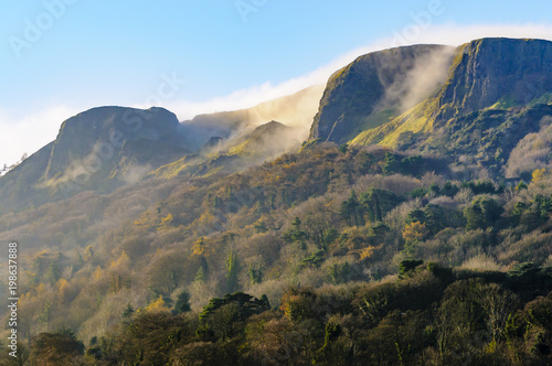 Fotografie, Tablou Mist/low clouds roll over Napoleon's Nose, Cave Hill, Belfast in late autumn s