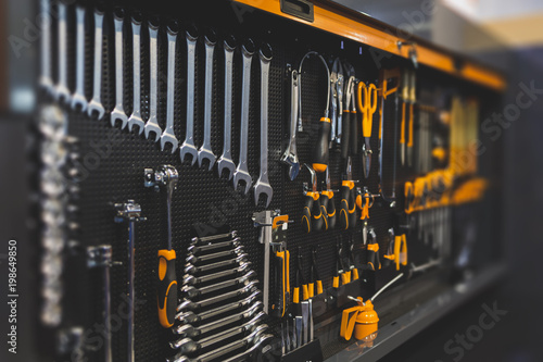 Fototapeta Work tools in a modern wall organizer obraz