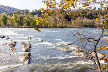 Harper's Ferry Blue Potomac River Closeup Riverside With Colorful Orange Yellow Foliage Fall Autumn By Small Village Town In West Virginia, WV