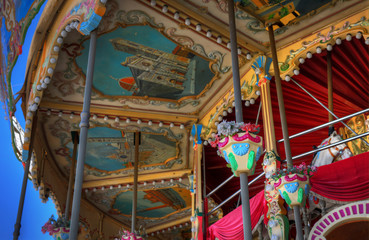 detail of ancient carousel of 700 with many colors