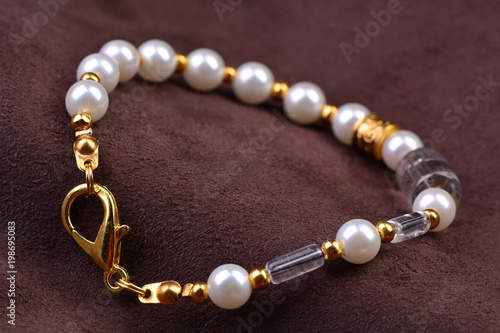 Pearl beads on a suede background