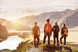 canvas print picture - Four friends sunset mountains travel concept