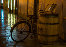 Rainy Vintage Bike And Wooden Barrel