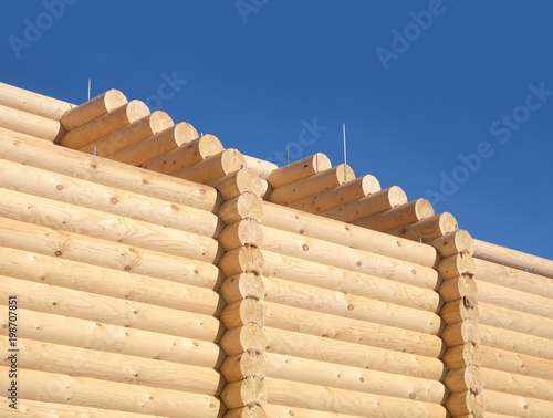 Top part of big rural house wall constructed from sandy brown smooth planed heav Canvas Print