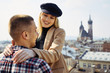 Lovely couple stand on city landscape and hug each other
