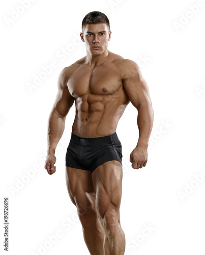 Muscular tanned man in a beautiful pose on a white background. Isolated. Wall mural